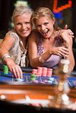 Two women gambling at roulette table