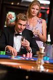 Couple gambling at roulettte table