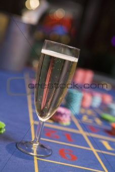 Close up of champagne glass on roulette table