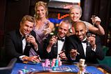 Group of friends gambling at roulette table