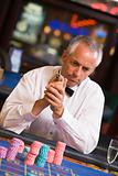 Man gambling at roulette table