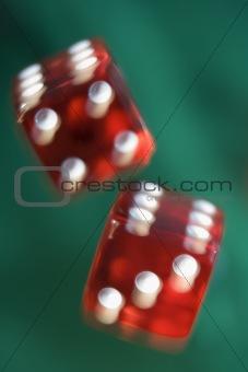 Pair of red dice being thrown