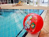 Red ball in a swimming pool