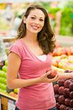 Young woman shopping in produce department