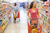 Two women shopping in supermarket