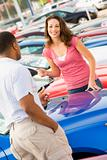 Woman talking to car salesman