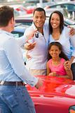 Young family picking up new car