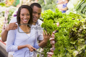 Couple buying fresh produce