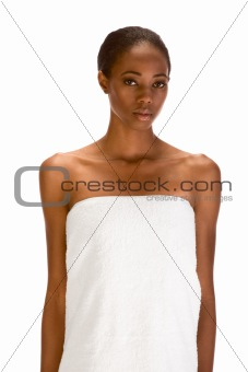 Afro-American female wrapped in white bath towel