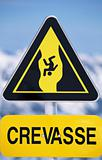 Warning sign in a snow covered area