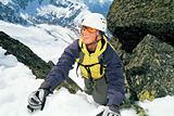 Mountaineer climbing a steep slope.