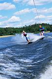 A man and woman water-skiing