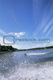 A young woman water skiing