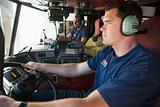 A firefighter driving a fire engine