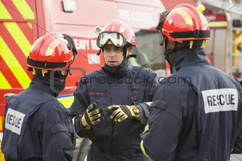 A firefighter giving instructions to his team