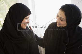 Two Middle Eastern women talking together