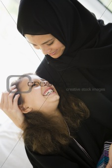 A Middle Eastern woman with her daughter