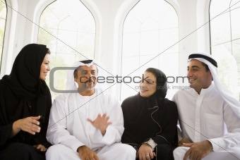 A Middle Eastern family sitting together