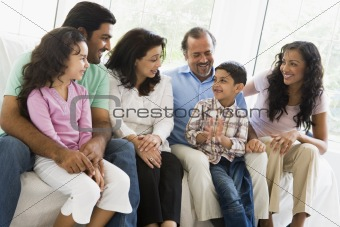 A Middle Eastern family sitting together on a couch