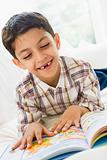 A Middle Eastern boy reading a book