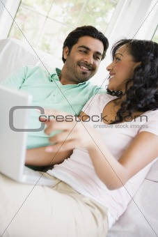 A Middle Eastern couple sitting with a laptop