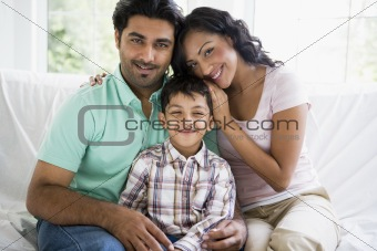 A Middle Eastern couple with their son