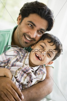 A Middle Eastern man with his son