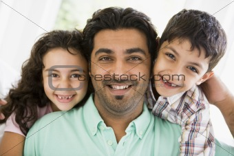 A Middle Eastern man with his children