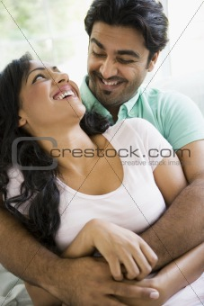 A Middle Eastern couple cuddling
