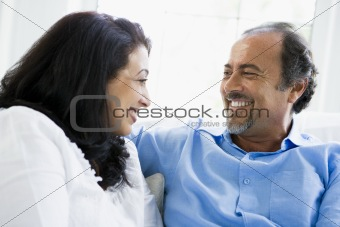 A Middle Eastern couple sitting at home