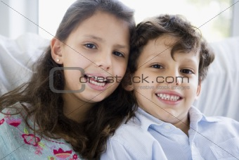 Portrait of two Middle Eastern children at home