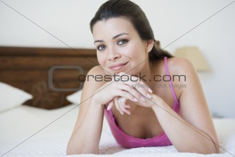 A Middle Eastern woman lying on a bed