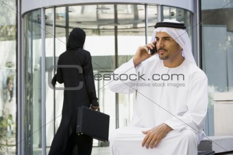 A Middle Eastern businessman talking on a mobile phone