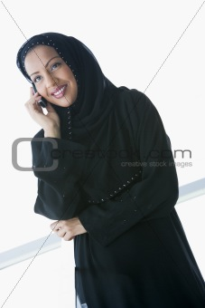 A Middle Eastern businesswoman talking on the phone