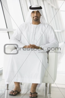 A Middle Eastern businessman sitting in a chair