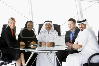 A  business meeting with Middle Eastern and caucasian men and wo