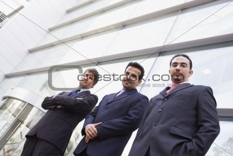Group of businessmen outside office building