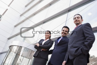 Group of business people outside office building