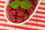 Raspberries and Leaves on a Plate