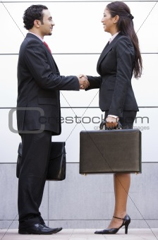 Business meeting outside office