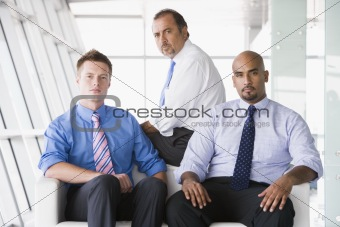 Group of businessmen sitting in lobby