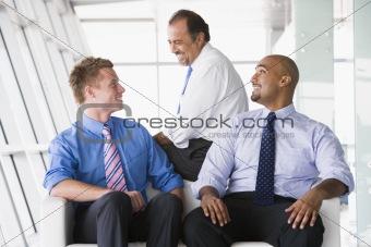 Group of businessmen talking in lobby