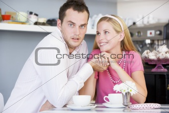 A young couple enjoying tea together