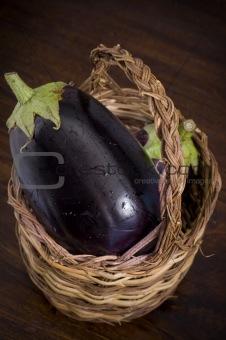 aubergines inside basket