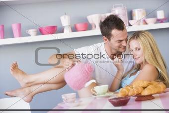 Flirtatious couple enjoying breakfast