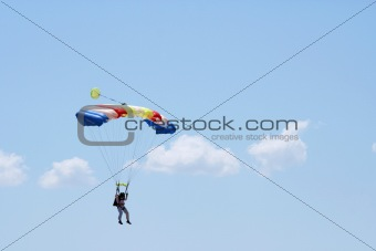 Parachuter and clouds