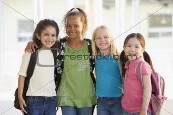 Three kindergarten girls standing together