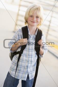Portrait of kindergarten boy with backpack