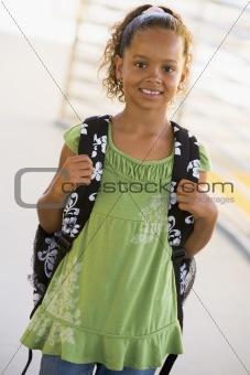 Portrait of kindergarten girl with backpack