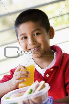 Boy eating lunch at kindergarten